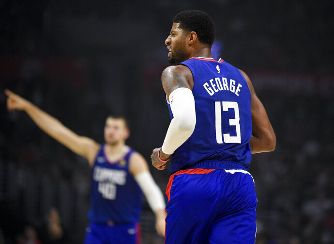 Los Angeles Clippers forward Paul George reacts after a shot by Maurice Harkless during the first half of the team's NBA basketball game against the Atlanta Hawks in Los Angeles, Saturday, Nov. 16, 2019. (AP Photo/Kelvin Kuo)