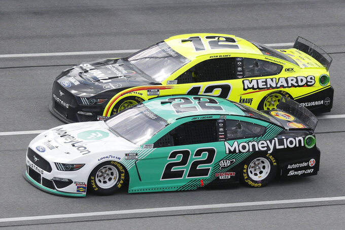 Joey Logano (22) and Ryan Blaney (12) race side-by-side during a NASCAR Cup Series auto race at Talladega Superspeedway in Talladega Ala., Monday, June 22, 2020. (AP Photo/John Bazemore)