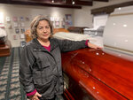 Magda Maldonado, owner of Continental Funeral Home in Los Angeles, poses in her mortuary on Dec. 30, 2020. Southern California funeral homes are turning away bereaved families because they're running out of space for all the bodies piling up during an unrelenting coronavirus surge that has sent COVID-19 death rates to new highs.