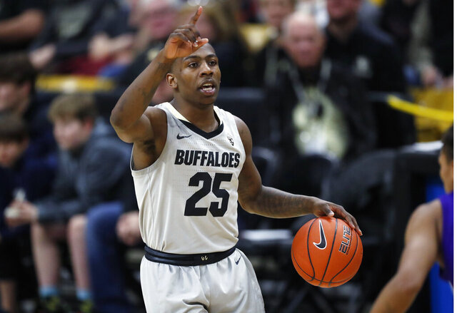 Colorado guard McKinley Wright IV directs teammates while bringing the ball up the court against Washington in the second half of an NCAA college basketball game Saturday, Jan. 25, 2020, in Boulder, Colo.  (AP Photo/David Zalubowski)