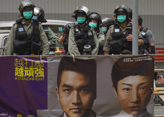 Riot police stand guard at Central during the second day of debate on a contentious bill that would criminalize insulting or abusing the Chinese national anthem, in Hong Kong, Thursday, May 28, 2020. (AP Photo/Vincent Yu)