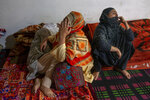 Relatives mourn during the joint funeral of a politician Sheikh Wasim Bari, his father and brother in Bandipora town, north of Srinagar, Indian controlled Kashmir, Thursday, July 9, 2020. Unidentified assailants late Wednesday fatally shot Bari, a leader with Prime Minister Narendra Modi's Bharatiya Janata Party, along with his father and brother in Kashmir, police said, in a first major attack against India's ruling party members in the disputed region. (AP Photo/ Dar Yasin)