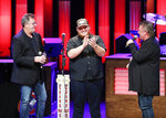 Vince Gill, left, and Joe Diffie, right, welcome Luke Combs to the Grand Ole Opry at