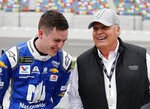 Alex Bowman, left, and car owner Rick Hendrick laugh on pit road during qualifying for the Daytona 500 auto race at Daytona International Speedway, Sunday, Feb. 10, 2019, in Daytona Beach, Fla. (AP Photo/Terry Renna)