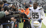 FILE - In this Dec. 24, 2017, file photo, Los Angeles Chargers tight end Antonio Gates (85) greets fans before an NFL football game against the New York Jets in East Rutherford, N.J. Gates announced his retirement, Tuesday, Jan. 14, 2020,  following a 16-year career that saw him finish with 116 touchdowns, which is the most by a tight end in NFL history. (AP Photo/Bill Kostroun, File)