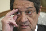 Cyprus' president Nicos Anastasiades adjusts his glasses during an interview with Associate Press at the presidential palace in capital Nicosia, Cyprus, Tuesday Sept. 17, 2019. Anastasiades says Turkey's