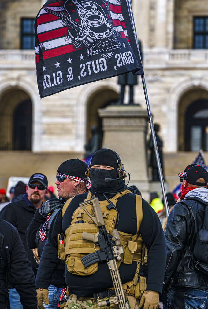 Protesters attended a rally in support of President Donald Trump on the steps of the Minnesota State Capitol on Wednesday, Jan. 6, 2021 in St. Paul, Minn. (Richard Tsong-Taatarii/Star Tribune via AP)
