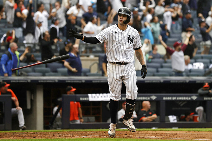 New York Yankees' Gary Sanchez throws his bat after hitting a grand slam against the Baltimore Orioles during the second inning of a baseball game on Sunday, Sept. 5, 2021, in New York. (AP Photo/Adam Hunger)