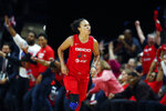 FILE - In this Oct. 10, 2019, file photo, Washington Mystics guard Kristi Toliver celebrates after her 3-point basket during the first half of Game 5 of basketball's WNBA Finals against the Connecticut Sun in Washington. Toliver is also an assistant coach with the Washington Wizards. (AP Photo/Alex Brandon, File)