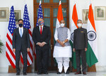 U.S. Secretary of State Mike Pompeo, second left, and Secretary of Defence Mark Esper, left, stand for photographs with Indian Foreign Minister Subrahmanyam Jaishankar, right, and Defence Minister Rajnath Singh ahead of their meeting at Hyderabad House in New Delhi, India, Tuesday, Oct. 27, 2020. In talks on Tuesday with their Indian counterparts, Pompeo and Esper are to sign an agreement expanding military satellite information sharing and highlight strategic cooperation between Washington and New Delhi with an eye toward countering China. (Adnan Abidi/Pool via AP)