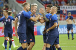 Slovakia's Adam Nemec, left, celebrates with teammates after scoring the opening goal during a friendly soccer match between Slovakia and Denmark in Trnava, Slovakia, Wednesday, Sept. 5, 2018. Every player in Denmark's squad are uncapped following a dispute between Denmark's star players and the Danish Football Association. (AP Photo/Ronald Zak)
