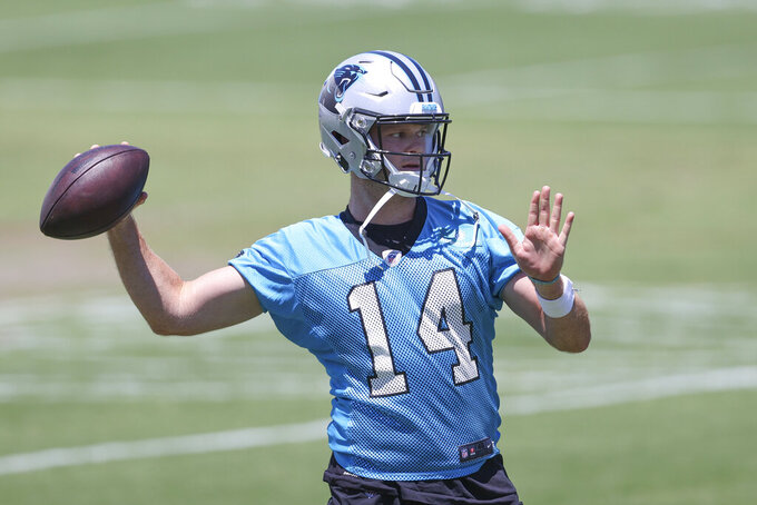 Carolina Panthers quarterback Sam Darnold throws a pass during NFL football practice in Charlotte, N.C., Tuesday, June 15, 2021. (AP Photo/Nell Redmond)