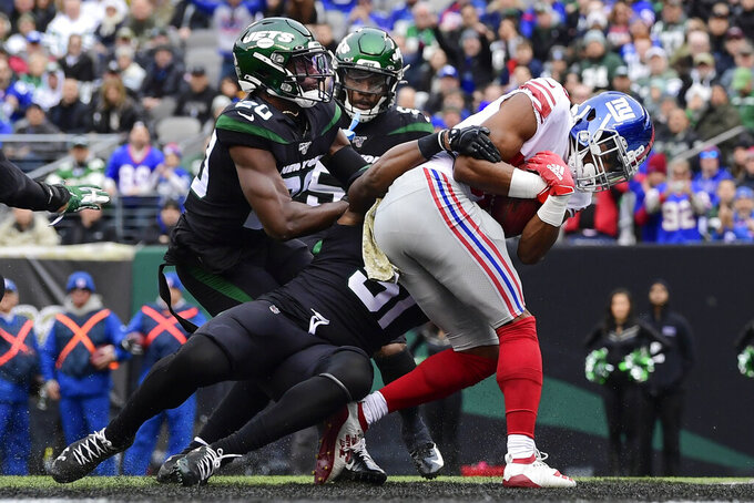 New York Giants' Darius Slayton runs past New York Jets' Marcus Maye (20) for a touchdown during the first half of an NFL football game Sunday, Nov. 10, 2019, in East Rutherford, N.J. (AP Photo/Steven Ryan)