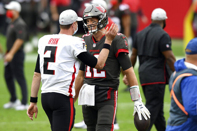 Atlanta Falcons quarterback Matt Ryan (2) congratulates Tampa Bay Buccaneers quarterback Tom Brady (12) after an NFL football game Sunday, Jan. 3, 2021, in Tampa, Fla. (AP Photo/Jason Behnken)
