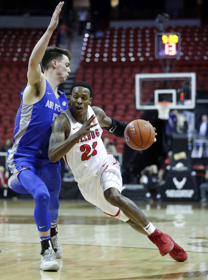 Fresno State's Deshon Taylor drives past Air Force's Christopher Joyce during the second half of an NCAA college basketball game in the Mountain West Conference men's tournament Thursday, March 14, 2019, in Las Vegas. (AP Photo/Isaac Brekken)