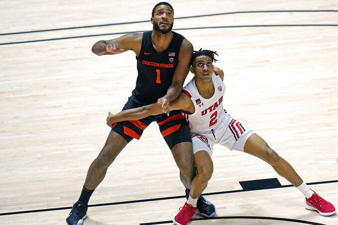 Oregon State forward Maurice Calloo (1) and Utah guard Ian Martinez (2) work for position under the boards during the first half of an NCAA college basketball game Wednesday, March 3, 2021, in Salt Lake City. (AP Photo/Rick Bowmer)