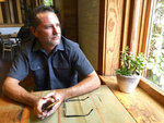 In this Monday, July 8, 2019 photo, Troy Young, a hemp grower in North Salt Lake, stops for breakfast at a nearby coffee shop before returning to his indoor grow facility. Young, who recently applied for a medical marijuana growers license in Utah, lost his mother to an opioid addiction. If she had access to less destructive pain-relieving drug, like marijuana, Young said maybe she'd still be alive. (AP Photo/Morgan Smith)