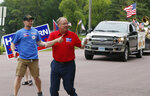 In this June 10, 2018 photo, Minnesota 1st District congressional candidate Jim Hagedorn gives a thumbs up as he works a parade in Waterville, Minn. Waterville's 54th annual Bullhead Days parade included Republican Hagedorn and Democrat Dan Feehan, candidates who came to shake as many hands as they could in the open seat race which promises to be one of the most closely watched races in the country. (AP Photo/Jim Mone)