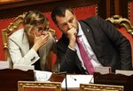 Italian Deputy-Premier and Interior Minister, Matteo Salvini, right, listens to Minister of Public Administration, Giulia Bongiorno, at the Senate in Rome, Thursday, July 11, 2019. Opposition lawmakers want to question Italian Interior Minister Matteo Salvini about allegations a Russian oil deal was devised to fund his pro-Moscow League party. Democratic Party lawmakers are demanding that a parliamentary inquiry be held. (AP Photo/Gregorio Borgia)