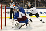 Colorado Avalanche goaltender Philipp Grubauer, front, stops a shot by Los Angeles Kings right wing Tyler Toffoli during the first period of an NHL hockey game Saturday, Feb. 15, 2020, at Air Force Academy, Colo. (AP Photo/David Zalubowski)