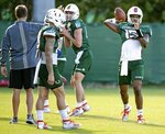 Miami Hurricanes quarterback Jarren Williams (15) passes the ball during practice drills at the University of Miami Greentree Practice Field in Coral Gables on Monday, July 29, 2019.(Al Diaz/Miami Herald via AP)