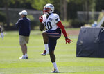 New England Patriots wide receiver Josh Gordon (10) warms up during an NFL football practice, Monday, Aug. 26, 2019, in Foxborough, Mass. (AP Photo/Steven Senne)