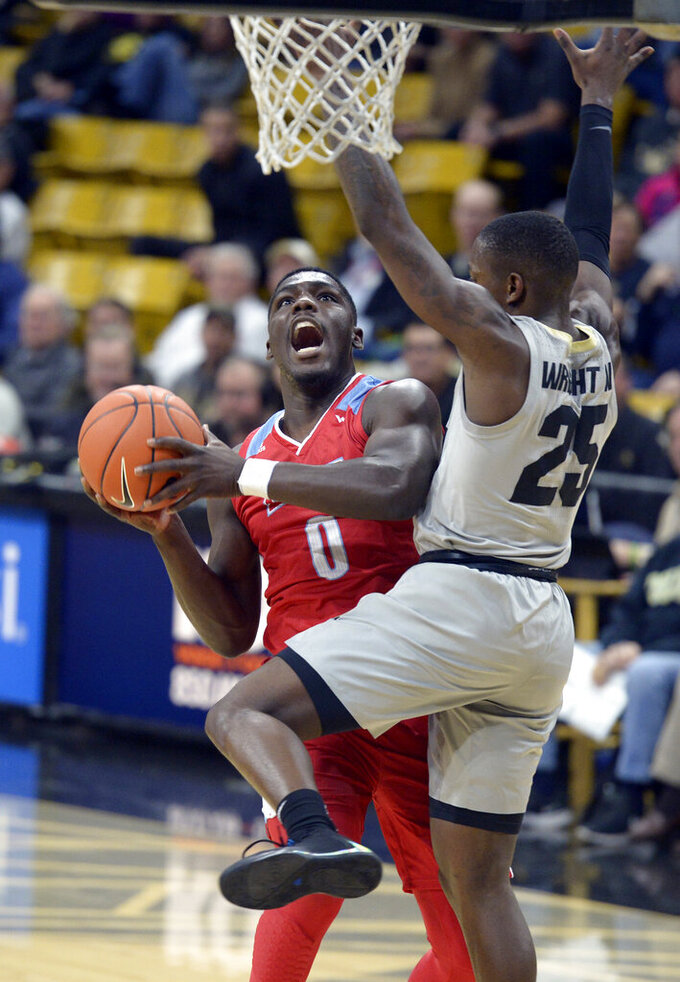Loyola Marymount guard Eli Scott, left, drives to the rim as Colorado guard McKinley Wright IV defends during the first half of an NCAA college basketball game Wednesday, Dec. 4, 2019, in Boulder, Colo. (AP Photo/Cliff Grassmick)