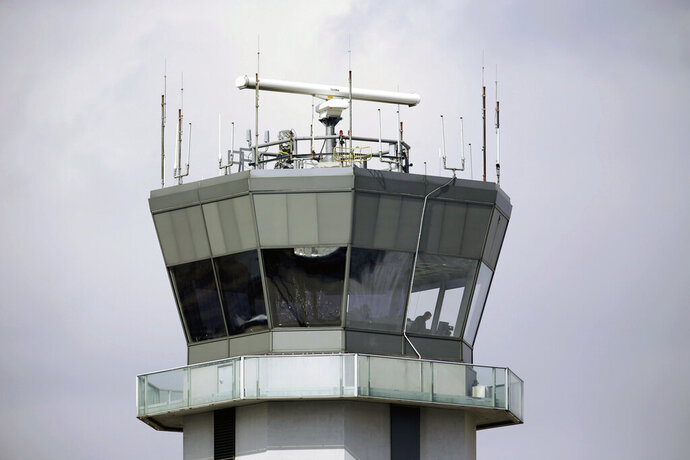 FILE - This March 12, 2013, file photo shows the air traffic control tower at Chicago's Midway International Airport. Federal regulators have not taken adequate steps to protect computer systems on airliners from hackers, a government watchdog agency reported on Friday, Oct. 9, 2020. The agency said the Federal Aviation Administration has not developed a training program for cybersecurity or test airplane computer systems that could be vulnerable to attack. (AP Photo/M. Spencer Green, File)