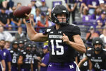 Northwestern quarterback Hunter Johnson (15) looks to pass against Michigan State during the first half of an NCAA college football game, Saturday, Sept. 21, 2019, in Evanston, Ill. (AP Photo/David Banks)