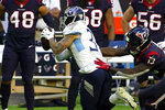 Tennessee Titans strong safety Amani Hooker (37) intercepts a pass in front of Houston Texans wide receiver Brandin Cooks (13) during the first half of an NFL football game Sunday, Jan. 3, 2021, in Houston. (AP Photo/Sam Craft)