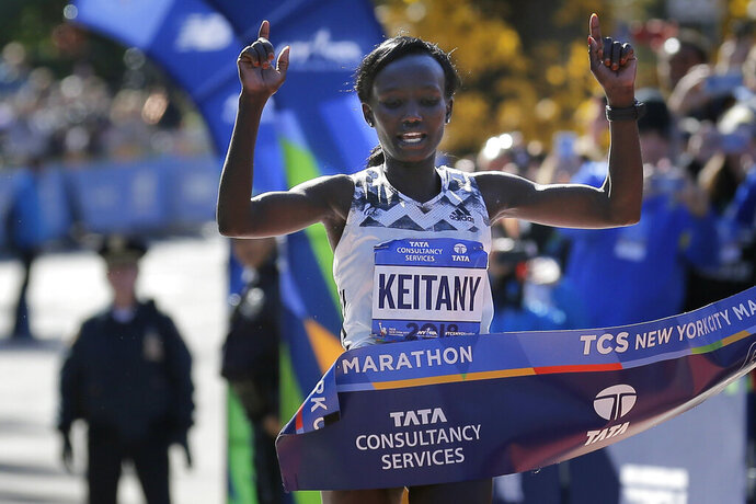 FILE - In this Nov. 4, 2018, file photo, Mary Keitany, of Kenya, crosses the finish line to win the women's division of the New York City Marathon in New York. Keitany is back for another bolt through the boroughs. Facing a thin field, she's eyeing another first-place finish.(AP Photo/Seth Wenig, File)
