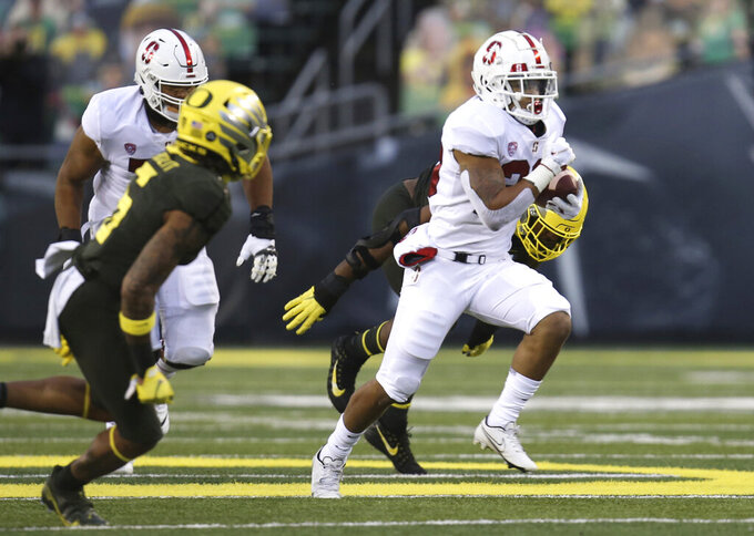 Stanford's Austin Jones, right, breaks for yardage against Oregon during the first quarter of an NCAA college football game Saturday, Nov. 7, 2020, in Eugene, Ore. (AP Photo/Chris Pietsch)