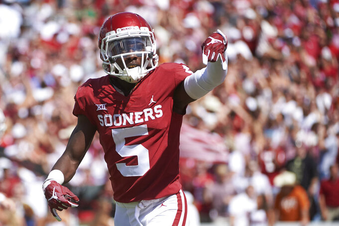 "FILE - In this Oct. 6, 2018, file photo, Oklahoma wide receiver Marquise Brown (5) gestures ""horns down""  as he celebrates after scoring a touchdown on a 77-yard reception against Texas in the second half of an NCAA college football game at the Cotton Bowl in Dallas. The Texas-Oklahoma rivalry is never short on bad blood between the Big 12 border states. (AP Photo/Cooper Neill, File)"