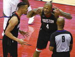 FILE - In this May 28, 2018, file photo, Houston Rockets forward PJ Tucker (4) and guard Gerald Green, left, argue a call with official Derrick Stafford during the second half of Game 7 of the NBA basketball Western Conference Finals against the Golden State Warriors, in Houston. The replays stream onto our sets in high-definition on a practically endless loop, with no detail too small, or too big, to ignore: fingernails nicking basketballs, horses veering out of line, baseball gloves grazing runners as they slide into second. About the only irrefutable evidence to come from any of it is that nobody agrees on what they saw. (AP Photo/Eric Christian Smith, File)