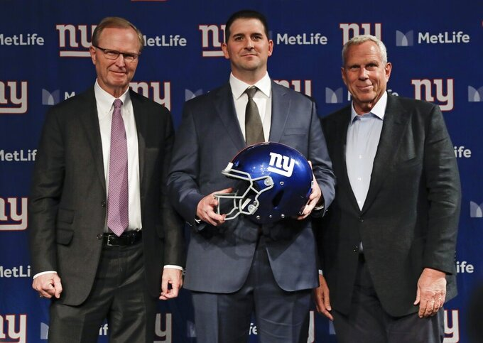 New York Giants new NFL football head coach Joe Judge, center, poses for photographs with New York Giants chairman and executive vice president Steve Tisch, right, and New York Giants CEO John Mara after a news conference Thursday, Jan. 9, 2020, in East Rutherford, N.J. (AP Photo/Frank Franklin II)