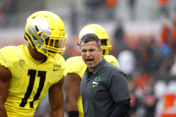 "FILE - In this Nov. 23, 2018, file photo, is Oregon head coach Mario Cristobal before an NCAA college football game in Corvallis, Ore. Cristobal, entering his second season as coach, has spoken about the importance of building team ``culture"" and insisting it's not just a tagline. The players seem to be genuinely buying in.  (AP Photo/Timothy J. Gonzalez, File)"