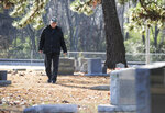 Don Collins is on a mission to find where every Morgan County resident who died in the Vietnam War is buried. In this image, he is seen on Tuesday, Dec. 3, 2019 at Decatur, Ala. City Cemetery, where two of the soldiers are buried. (Jeronimo Nisa/The Decatur Daily via AP)