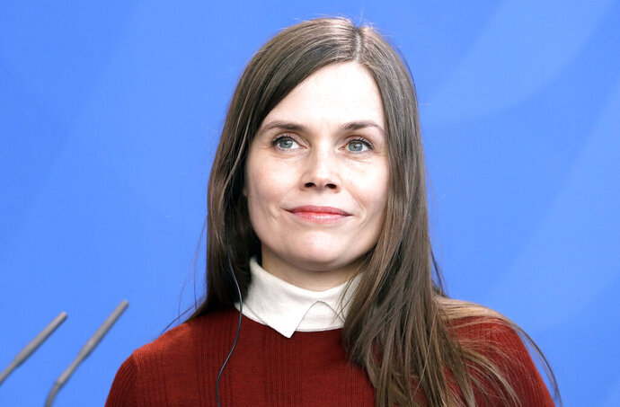 FILE -  In this Monday, March 19, 2018 file photo, Prime Minister of Iceland Katrin Jakobsdottir attends a press statement in Berlin, Germany. Iceland's leader has announced that she will skip U.S. Vice President Mike Pence's visit to her Nordic nation, opting instead to keep