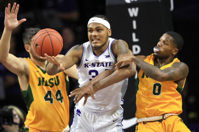 Kansas State forward Levi Stockard III (34) rebounds between North Dakota State forward Tyler Witz (44) and guard Vinnie Shahid (0) during the first half of an NCAA college basketball game in Manhattan, Kan., Tuesday, Nov. 5, 2019. (AP Photo/Orlin Wagner)