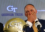 Newly hired Georgia Tech football coach Geoff Collins reacts during a news conference Friday, Dec. 7, 2018, in Atlanta. (AP Photo/John Bazemore)
