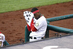 Washington Nationals' Victor Robles wipes his face at the dugout during the third inning of a baseball game against the Toronto Blue Jays, Monday, July 27, 2020, in Washington. (AP Photo/Nick Wass)