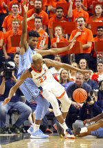 Virginia forward Mamadi Diakite (25) loses control of the ball next to Columbia forward Randy Brumant (13) during an NCAA college basketball game in Charlottesville, Va., Saturday, Nov. 16, 2019. (AP Photo/Andrew Shurtleff)