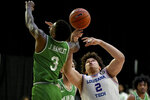 North Texas guard Javion Hamlet (3) knocks the ball away from Louisiana Tech forward Kenneth Lofton Jr. (2) in the second half of an NCAA college basketball game in the Conference USA men's tournament, in Frisco, Texas, Friday, March 12, 2021. North Texas won 54-48. (AP Photo/Matt Strasen)
