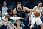 Boston Celtics' Marcus Smart, left, defends against Detroit Pistons' Blake Griffin, right, during the first half of an NBA basketball game in Boston, Wednesday, Feb. 13, 2019. (AP Photo/Michael Dwyer)