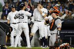 New York Yankees' Aaron Judge, center, and Gleyber Torres (25) celebrate after Torres' three-run home run during the fifth inning of the second game of a baseball doubleheader against the Baltimore Orioles, Monday, Aug. 12, 2019, in New York. (AP Photo/Frank Franklin II)