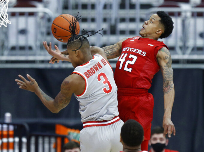 Rutgers guard Jacob Young, right, is fouled as he goes up for a shot against Ohio State guard Eugene Brown during the first half of an NCAA college basketball game in Columbus, Ohio, Wednesday, Dec. 23, 2020. (AP Photo/Paul Vernon)