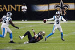 Carolina Panthers quarterback Teddy Bridgewater (5) scrambles past New Orleans Saints defensive end Marcus Davenport as offensive tackle Russell Okung (76) blocks in the first half of an NFL football game in New Orleans, Sunday, Oct. 25, 2020. (AP Photo/Brett Duke)