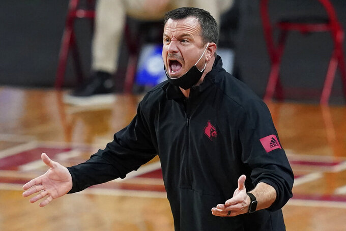 Louisville head coach Jeff Walz instructs his team in the first half of an NCAA college basketball game against Boston College, Thursday, Feb. 4, 2021, in Boston. (AP Photo/Elise Amendola)