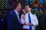 Democratic presidential candidate Pete Buttigieg, right, shares a light moment with husband, Chasten Glezman, while waiting to be introduced at a campaign event Thursday, May 9, 2019, in West Hollywood, Calif. (AP Photo/Jae C. Hong)