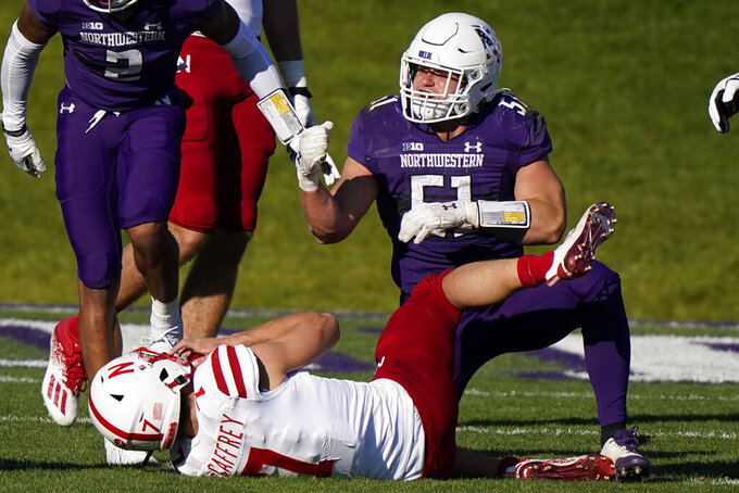 Northwestern linebacker Blake Gallagher, right, celebrates after he tackled Nebraska quarterback Luke McCaffrey during the second half of an NCAA college football game in Evanston, Ill., Saturday, Nov. 7, 2020. Northwestern won 21-13. (AP Photo/Nam Y. Huh)